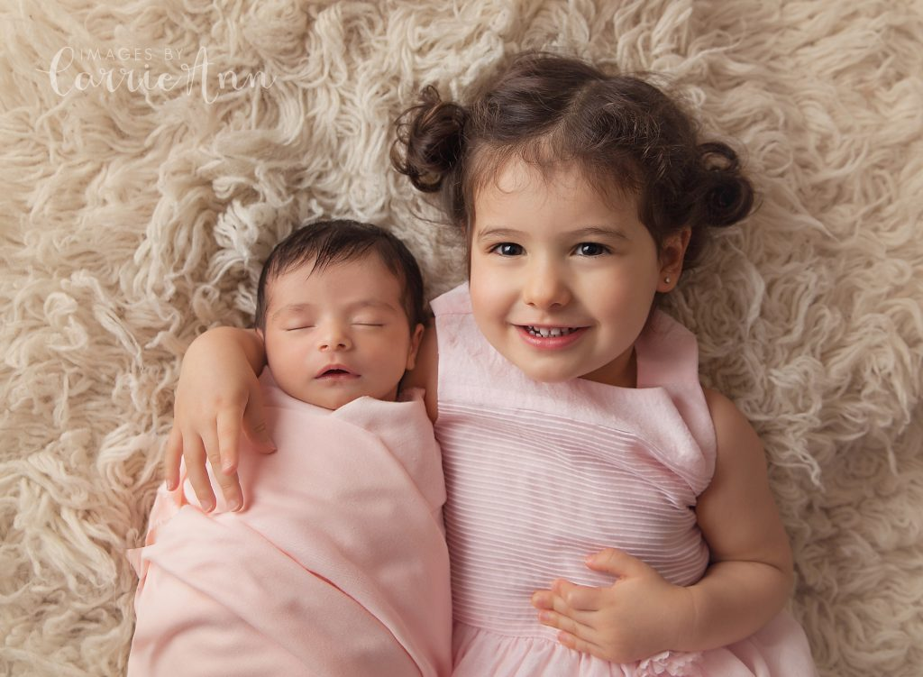 big sister with newborn sister