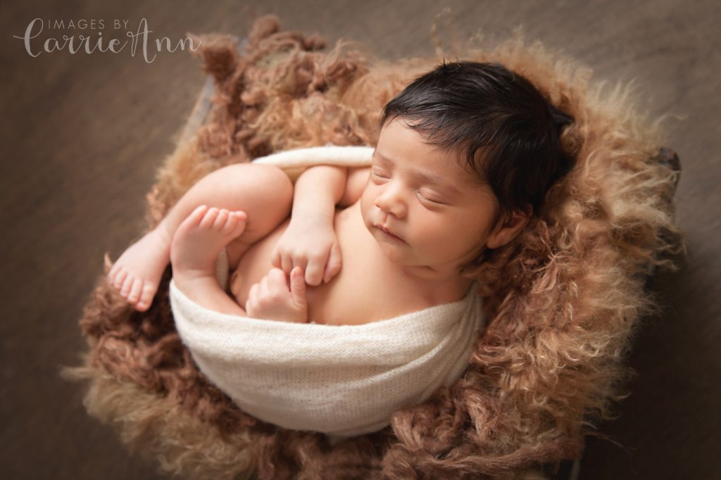 baby girl in rustic brown fur