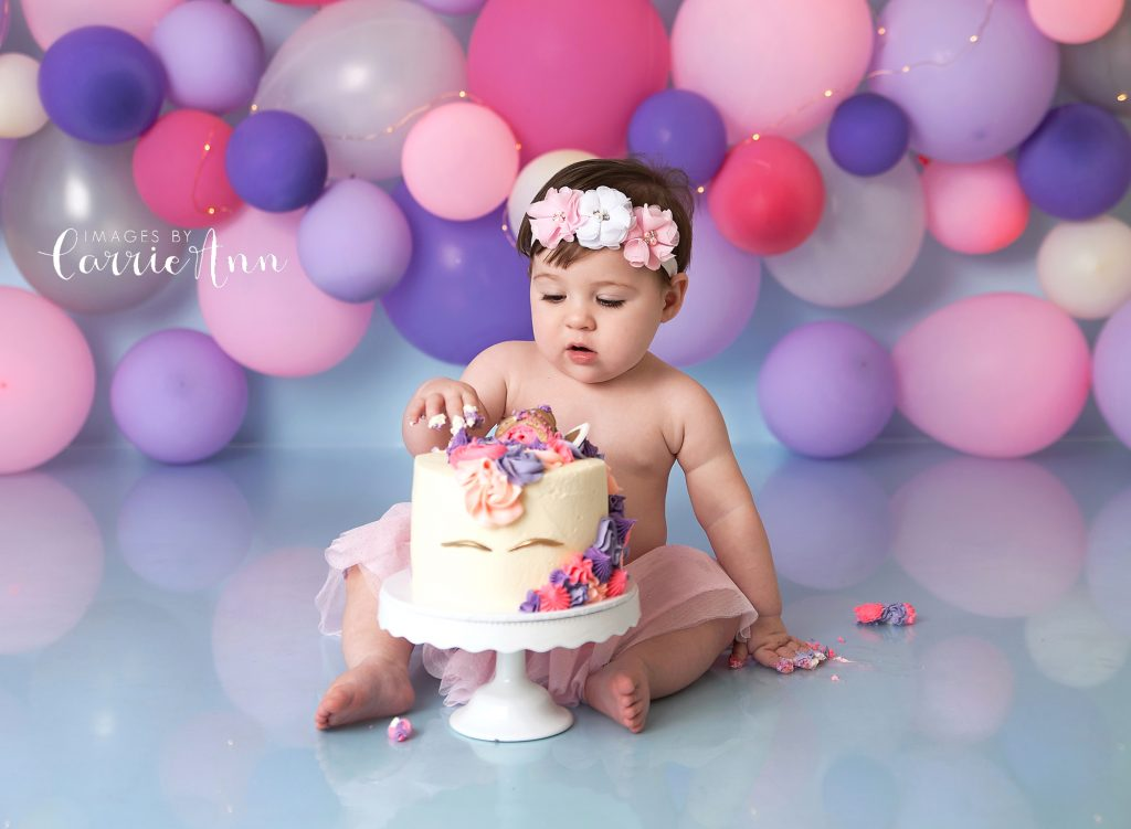 pink purple and silver balloon garland with teal backdrop unicorn