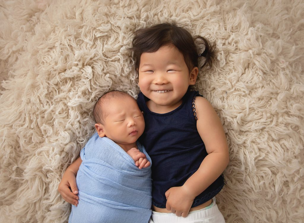 newborn brother with big sister
