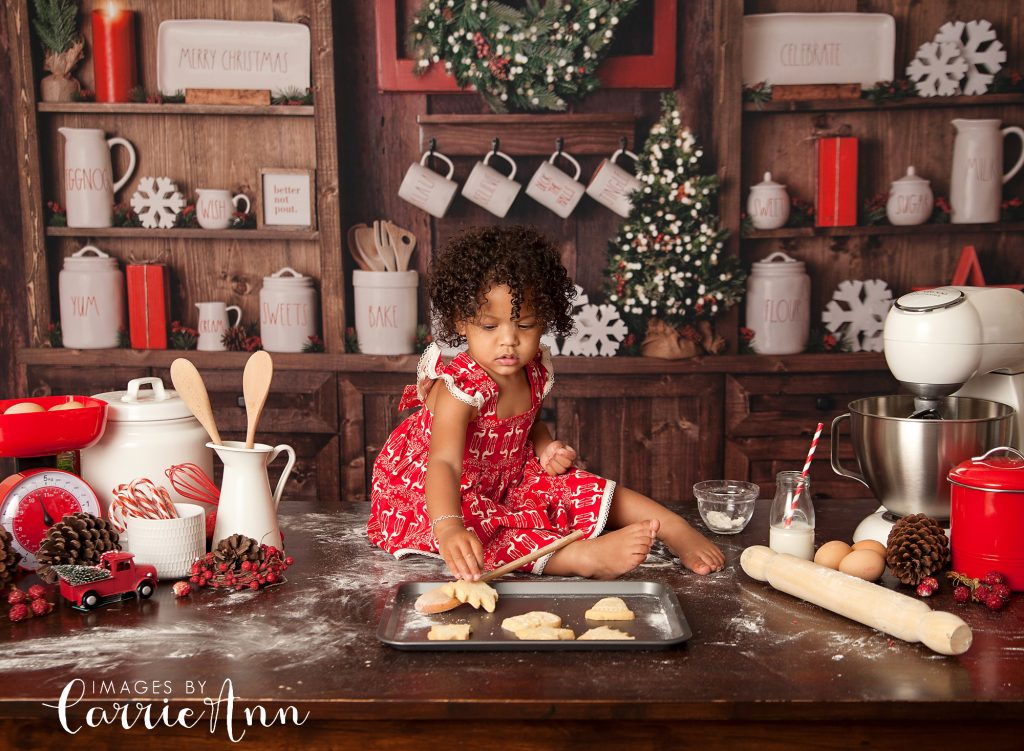 toddler girl sitting on bench in vintage kitchen with cookies
