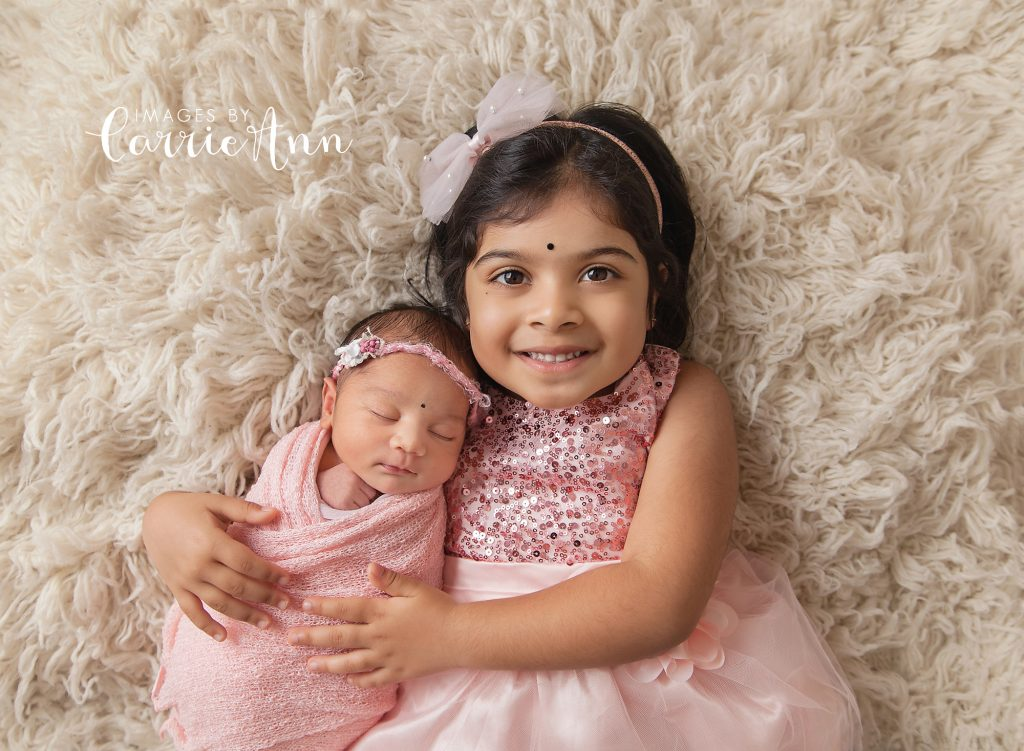older sister with newborn sister